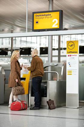 Lufthansa passengers using self bag drop