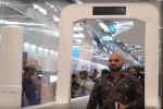Passengers use biometric tunnel for passport control at Dubai Airport