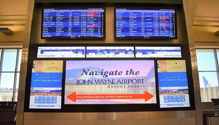 "Signs located at TSA entrances now combine JWA's Flight Information displays with two 46"" touchscreen wayfinding LED screens, and three 37"" horizontal LED screens that continually display the overall layout of the Terminal's concourse and gate numbers. [Image: ©John Wayne Airport]"