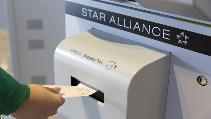 Star passengers at Narita now print and attach the bag tag themselves