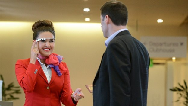 Virgin staff wearing Google Glass greets passenger