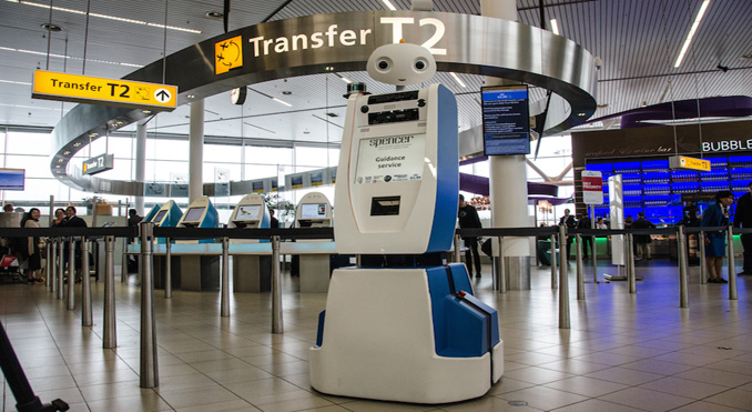 Spencer, the KLM robot, guides passengers to their gate