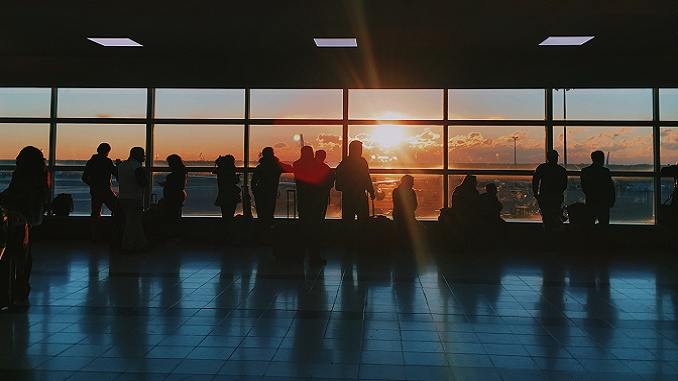 Passengers at airport gate
