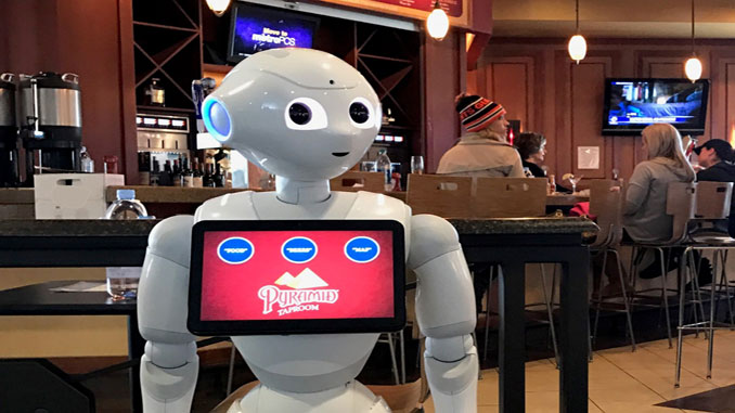 Pepper invites passengers to the bar at Oakland International