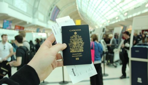 Person holding Canadian passport